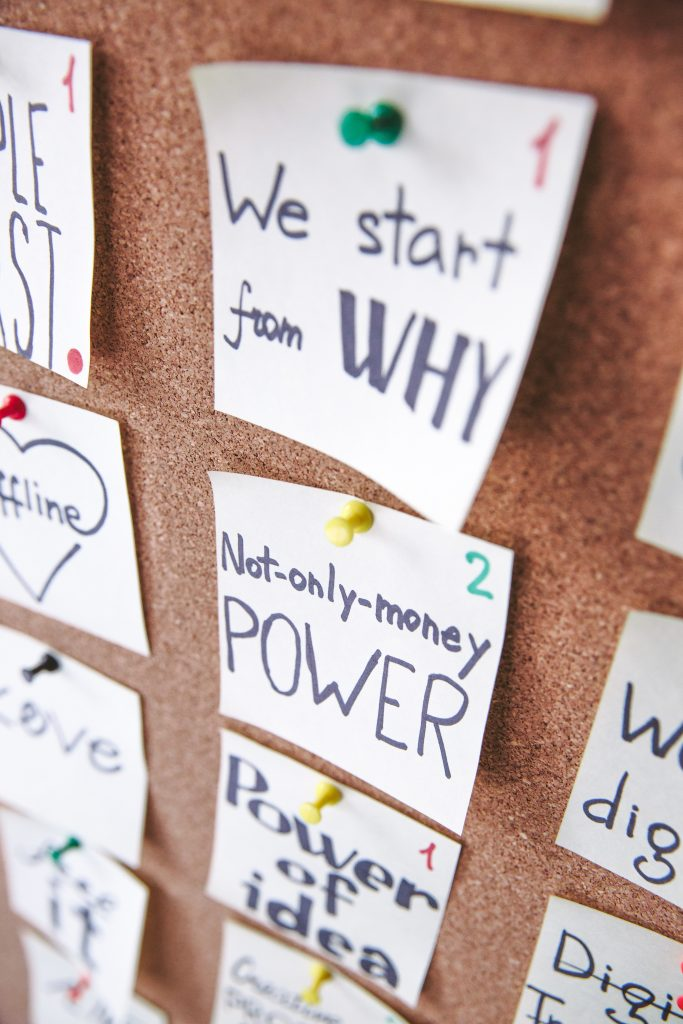 post-it notes working through company mission from why