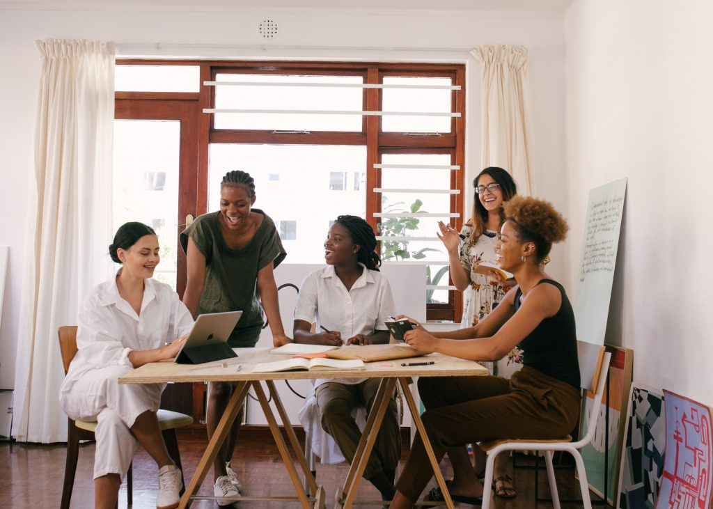 Group of women working together at a table.